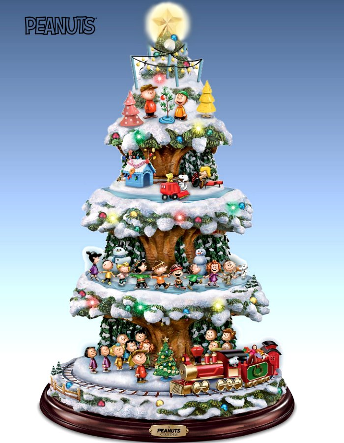 A PEANUTS Christmas Tabletop Tree With Lights, Music And Motion (Rotating Train, Skaters and Snoopy)