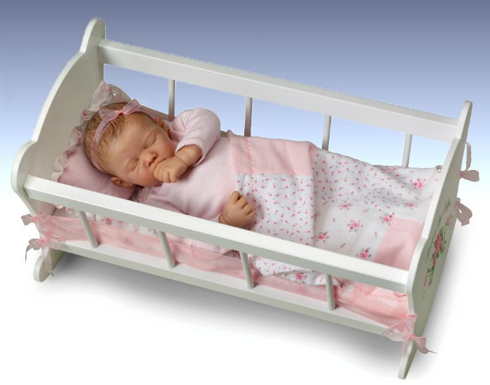 Rock-A-Bye Baby Doll with Musical Pillow - in her cradle